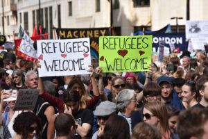Protesters in London calling on the UK Government to let more refugees into the country.