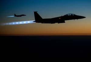 A pair of U.S. Air Force F-15E Strike Eagles fly over northern Iraq early in the morning of Sept. 23, 2014, after conducting airstrikes in Syria. These aircraft were part of a large coalition strike package that was the first to strike ISIL targets in Syria. (U.S. Air Force photo by Senior Airman Matthew Bruch/Released)